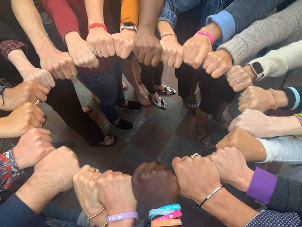 Source Team hands circle
